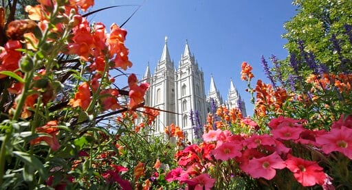 (AP Photo/Rick Bowmer, File). FILE - This Aug. 4, 2015 file photo, flowers bloom in front of the Salt Lake Temple, at Temple Square, in Salt Lake City. The Church of Jesus Christ of Latter-day Saints is reminding members that coffee is prohibited no ma...