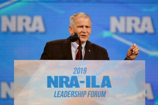 (AP Photo/Michael Conroy, File). FILE - In this April 26, 2019, file photo, National Rifle Association President Col. Oliver North speaks at the National Rifle Association Institute for Legislative Action Leadership Forum at Lucas Oil Stadium in Indian...