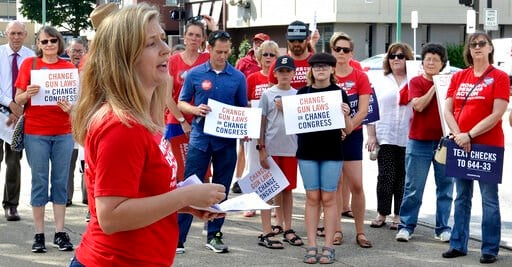 (Chris Dorst/Charleston Gazette-Mail via AP). Tosha Pelfrey of Moms Demand Action speaks during a rally to protest gun violence n front of the United Building in Charleston, W.Va., Saturday, Aug. 17, 2019.