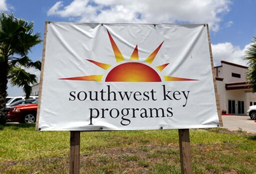 (AP Photo/Eric Gay, File). FILE - This June 20, 2014, file photo, shows a Southwest Key program sign in Brownsville, Texas. A provider of shelters for immigrant children is looking to reopen two facilities that the state of Arizona forced it to shutter...