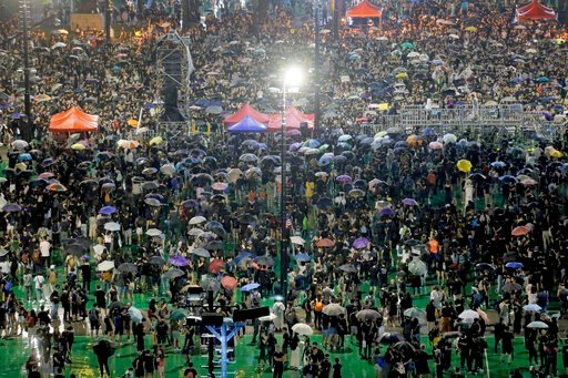 (AP Photo/Kin Cheung). Protesters attend a rally at Victoria Park in Hong Kong, Sunday, Aug. 18, 2019. Heavy rain fell on tens of thousands of umbrella-toting protesters Sunday as they marched from a packed park and filled a major road in Hong Kong, wh...