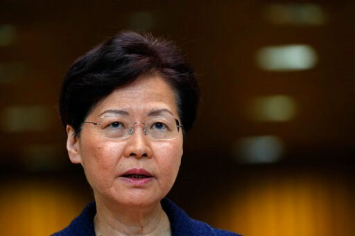 """(AP Photo/Vincent Yu). Hong Kong Chief Executive Carrie Lam listens to reporters questions at a press conference in Hong Kong Tuesday, Aug. 20, 2019. Lam said she's setting up a """"communication platform"""" to resolve differences in the Chinese city, which..."""