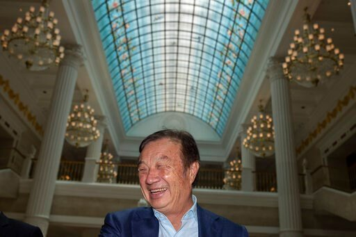 (AP Photo/Ng Han Guan). Huawei's founder Ren Zhengfei, reacts during an interview at the Huawei campus in Shenzhen in Southern China's Guangdong province on Tuesday, Aug. 20, 2019. Ren expects no relief from U.S. export curbs due to the political clima...