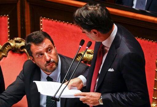 (AP Photo/Gregorio Borgia). Italian Premier Giuseppe Conte, right, looks at Deputy-Premier Matteo Salvini as he addresses the Senate in Rome, Tuesday, Aug. 20, 2019. Italian Premier Giuseppe Conte blasted the League's leader and Interior minister Matte...