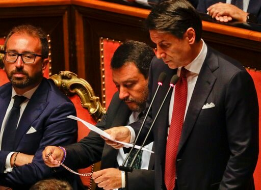 (AP Photo/Gregorio Borgia). Italian Premier Giuseppe Conte addresses the Senate as Deputy-Premier Matteo Salvini holds a rosary while sitting beside him, in Rome, Tuesday, Aug. 20, 2019. The political showdown on Tuesday was triggered two weeks ago by ...