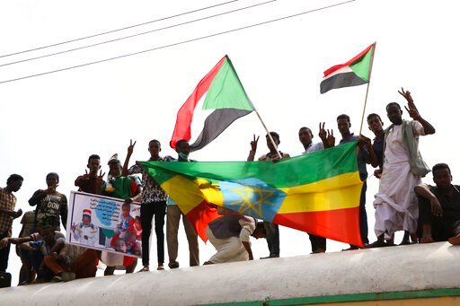 (AP Photo). Sudanese pro-democracy supporters celebrate a final power-sharing agreement with the ruling military council Saturday, Aug 17, 2019, in the capital, Khartoum. The deal paves the way for a transition to civilian-led government following the ...