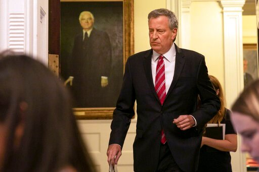 (AP Photo/Richard Drew). New York Mayor Bill de Blasio arrives to speak in the Blue Room at City Hall, Monday, Aug. 19, 2019. After five years of investigations and protests, the New York City Police Department on Monday fired Officer Daniel Pantaleo, ...