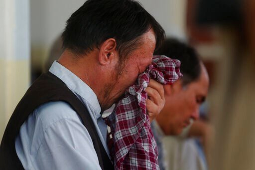 (AP Photo/Rafiq Maqbool). Men mourn for the victims of the Dubai City wedding hall bombing during a memorial service at a mosque in Kabul, Afghanistan, Tuesday, Aug. 20, 2019. Hundreds of people have gathered in mosques in Afghanistan's capital for mem...