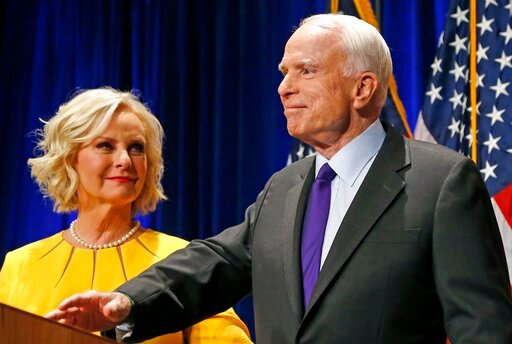(AP Photo/Ross D. Franklin, File). FILE - In this Tuesday, Nov. 8, 2016, file photo, Sen. John McCain, R-Ariz., right, pauses as his wife, Cindy McCain, looks at him on stage after giving his victory speech as he announces his win over Democratic chall...