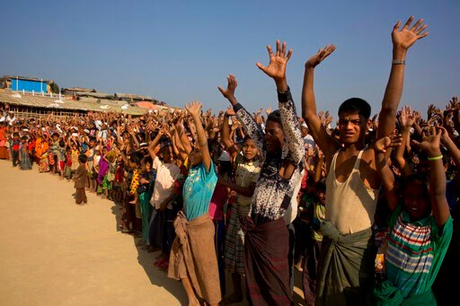 (AP Photo/Manish Swarup, File). FILE - In this Jan. 22, 2018, file photo, Rohingya children and refugees raise their hands and shout that they won't go back to Myanmar during a demonstration at Kutupalong near Cox's Bazar, Bangladesh. Officials from th...