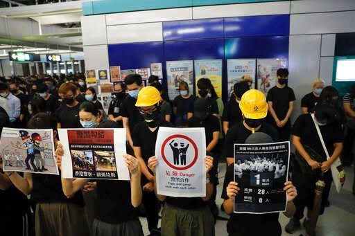 (AP Photo/Kin Cheung). Demonstrators stand during a protest at the Yuen Long MTR station, where demonstrators and others were violently attacked by men in white T-shirts following an earlier protest in July, in Hong Kong, Wednesday, Aug. 21, 2019.  Jap...