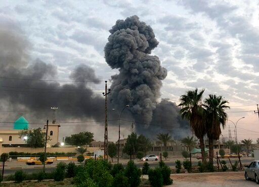 (AP Photo/Loay Hameed, File). FILE - In this Monday, Aug. 12, 2019 file photo, plumes of smoke rise after an explosion at a military base southwest of Baghdad, Iraq. A fact-finding committee appointed by the Iraqi government to investigate a massive mu...