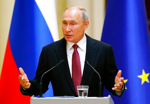 (AP Photo/Alexander Zemlianichenko, Pool). Russian President Vladimir Putin speaks during a news conference after his meeting with President of the Republic of Finland Sauli Niinisto at the President's official residence Mantyniemi in Helsinki, Finland...