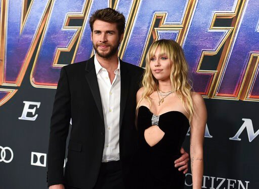 "(Photo by Jordan Strauss/Invision/AP, File). FILE - In this Monday, April 22, 2019, file photo, Liam Hemsworth, left, and Miley Cyrus arrive at the premiere of ""Avengers: Endgame"" at the Los Angeles Convention Center. Liam Hemsworth is seeking a divorc..."