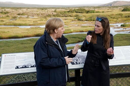(AP Photo/Egill Bjarnason). Iceland's Prime Minister Katrin Jakobsdottir, right, meets with German Chancellor Angela Merkel at Thingvellir National Park, about 40km from Reykjavik in Iceland, Monday Aug. 19, 2019. Merkel met with Jakobsdottir on Monday...