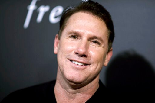 (Photo by Richard Shotwell/Invision/AP, File). FILE - In this Feb. 1, 2016, file photo, novelist Nicholas Sparks attends a special screening in Los Angeles. The trial is getting underway, Wednesday, Aug. 14, 2019, in a lawsuit that accuses Sparks of de...