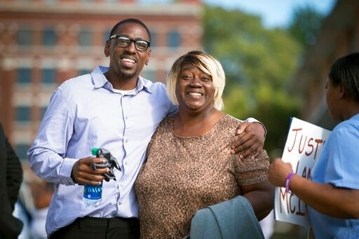 (Tammy Ljungblad /The Kansas City Star via AP, File). FILE - In this Oct. 13, 2017, file photo, Lamonte McIntyre, left, who was imprisoned for 23 years for a 1994 double murder in Kansas that he always said he didn't commit, walks out of a courthouse i...