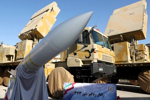 (Iranian Presidency Office via AP). In this photo released by the official website of the office of the Iranian Presidency, Iran-made Bavar-373 air-defense missile system is seen after being unveiled by President Hassan Rouhani, Iran, Thursday, Aug. 22...