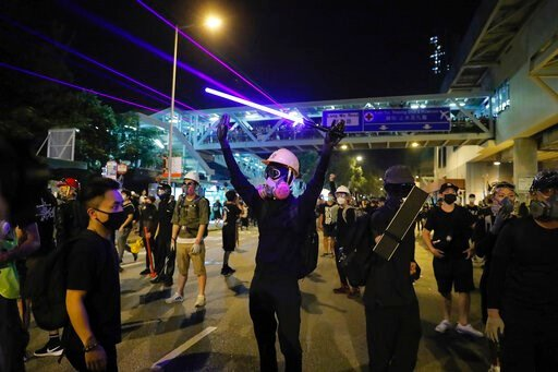 (AP Photo/Kin Cheung). Demonstrators shine laser pointers outside the Yuen Long MTR station during a protest in Hong Kong, Wednesday, Aug. 21, 2019. Hong Kong riot police faced off briefly with protesters occupying a suburban train station Wednesday ev...