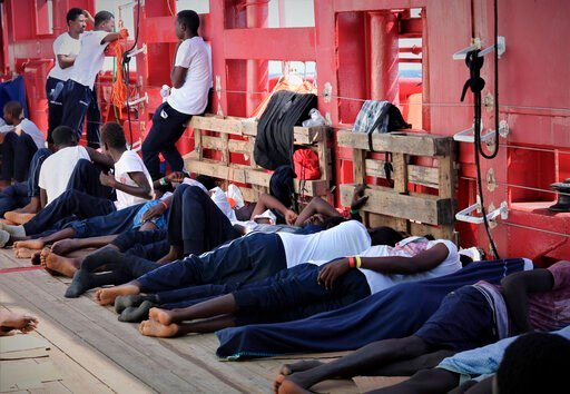 (Hannah Wallace Bowman/MSF via AP). In this Aug. 13, 2019 photo made available Monday, Aug. 19, 2019, rescued migrants rest on the deck of the Norwegian-flagged Ocean Viking vessel, operated by two French humanitarian groups, as it sails in the waters ...