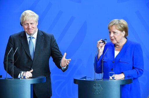 (Bernd Von Jutrczenka/dpa via AP). Germany's Chancellor Angela Merkel and British Prime Minister Boris Johnson attend a joint press conference, in Berlin, Wednesday, Aug. 21, 2019. German Chancellor Angela Merkel says she plans to discuss with UK Prime...