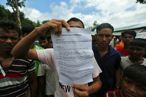(AP Photo/Mahmud Hossain Opu). A Rohingya refugee displays to journalists a demand letter about Rohingya repatriation at Nayapara camp in Cox's Bazar, Bangladesh, Thursday, Aug.22, 2019. Bangladesh's refugee commissioner said Thursday that no Rohingya ...