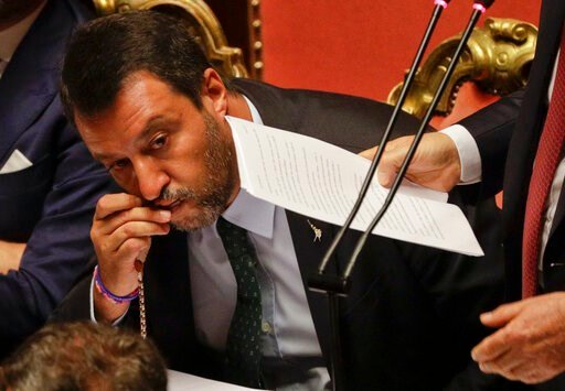 (AP Photo/Gregorio Borgia, File). FILE - In this Aug. 20, 2019, file photo, Italian Deputy-Premier Matteo Salvini kisses a rosary as Premier Giuseppe Conte addresses the Senate in Rome. For months now, Salvini, a divorced father of two children by two ...