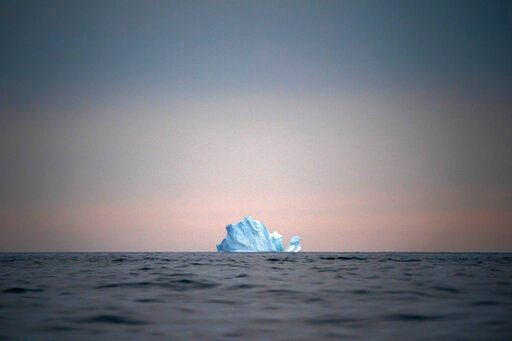 (AP Photo/Felipe Dana, File). FILE - In this Aug. 15, 2019, file photo, a large Iceberg floats away as the sun sets near Kulusuk, Greenland. As warmer temperatures cause the ice to retreat the Arctic region is taking on new geopolitical and economic im...