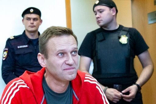 (AP Photo/Alexander Zemlianichenko). Russian leader Alexei Navalny speaks to the media prior to a court session in Moscow, Russia, Thursday, Aug. 22, 2019. Navalny is due in court, where a judge will consider extending his detention in lieu of days spe...