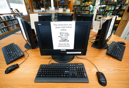 (AP Photo/Tony Gutierrez). Signs on a bank of computers tell visitors that the machines are not working at the public library in Wilmer, Texas, Thursday, Aug. 22, 2019. Cyberattacks that recently crippled nearly two dozen Texas cities have put other lo...