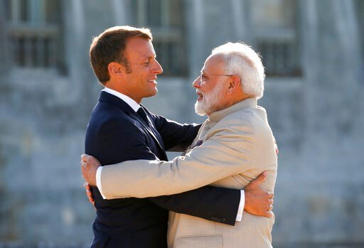 (Pascal Rossignol, Pool via AP). French President Emmanuel Macro, left, welcomes Indian Prime Minister Narendra Modi before a meeting at the Chateau of Chantilly, north of Paris, Thursday Aug. 22, 2019. Indian Prime Minister Narendra Modi will be a gue...