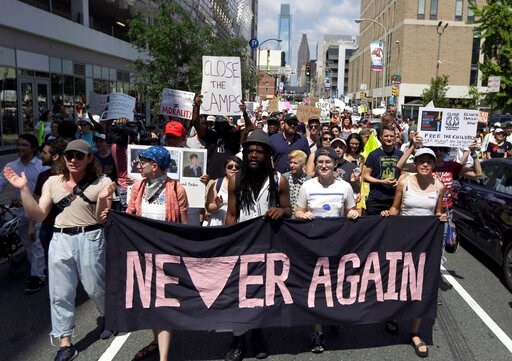 (AP Photo/Jacqueline Larma, File). FILE - In this July 4, 2019, file photo, protesters assembled by a majority Jewish group called Never Again Is Now walk through traffic as they make their way to Independence Mall in Philadelphia. A fledgling coalitio...