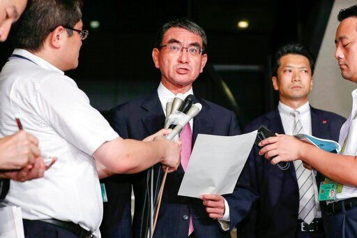 (Naoya Osato/Kyodo News via AP). Japanese Foreign Minister Taro Kono, center, speaks to reporters following South Korea's announcement that it will terminate an intelligence-sharing deal with Japan, at Foreign Ministry in Tokyo Thursday, Aug. 22, 2019....