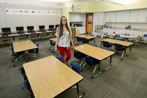 (AP Photo/Rick Bowmer). First-grade teacher Hillary Madrigal is photographed in her classroom Thursday, Aug. 22, 2019, in Salt Lake City. Across the country, teachers and school districts alike are grappling with the latest political and economic reali...