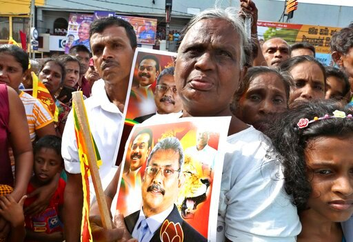 (AP Photo/Sajeewa Chinthaka). In this Aug 16, 2019, photo, supporters of former Sri Lankan Defense Secretary and opposition's presidential candidate Nandasena Gotabaya Rajapaksa, carry his portrait, and await his arrival in Ambalanthota, Sri Lanka. Got...