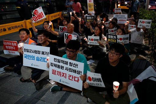 (AP Photo/Lee Jin-man). South Korean protesters react during a rally about the General Security of Military Information Agreement, or GSOMIA, in front of Japanese embassy in Seoul, South Korea, Thursday, Aug. 22, 2019. South Korea said Thursday it will...