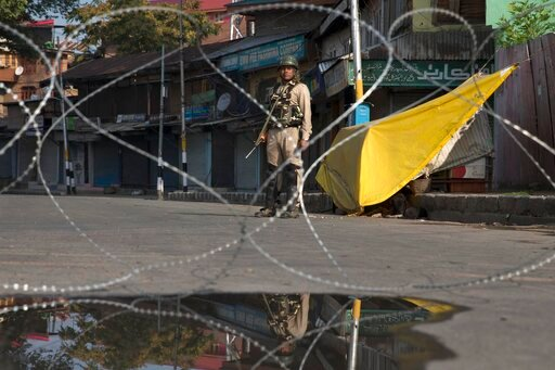 (AP Photo/Dar Yasin). An Indian paramilitary soldier stands guard near a temporary checkpoint during lockdown in Srinagar, Indian controlled Kashmir, Friday, Aug. 23, 2019. The latest crackdown began just before Prime Minister Narendra Modi's Hindu nat...