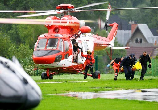 (AP Photo/Bartlomiej Jurecki). Rescue helicopter have brought to hospital the first people injured by a lighting that struck in Poland's southern Tatra Mountains during a sudden thunderstorm, in Zakopane, Poland, on Thursday, Aug. 22, 2019.