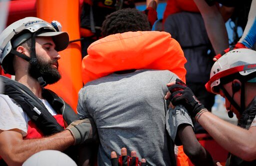(Hannah Wallace Bowman/MSF/Sos Mediterranee via AP). In this photo taken Saturday and released Sunday, Aug. 11, 2019, a rescue team of the Ocean Viking ship, operated by the NGOs Sos Mediterranee and Doctors Without Borders, helps a person rescued from...