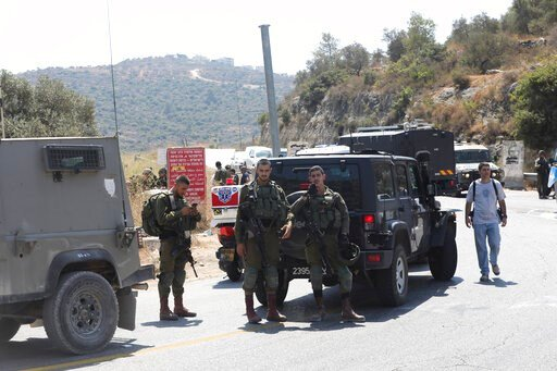(AP Photo/Mahmoud Illean). Israeli soldiers secure an area near Dolev settlement in the West Bank, Friday, Aug. 23, 2019, after three Israelis were wounded in an explosion. The Israeli military said it suspects the explosion near Dolev settlement, nort...