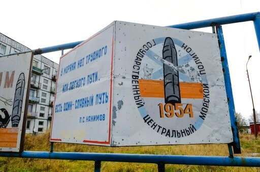 """(AP Photo/Sergei Yakovlev). This photo taken on Oct. 7, 2018, shows a billboard that reads """"The State Central Navy Testing Range"""" near residential buildings in the village of Nyonoksa, northwestern Russia. The Aug. 8, 2019, explosion of a rocket engine..."""