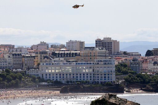 (AP Photo/Bob Edme). A security helicopter flies over the G7 summit venue Casino Bellevue, Wednesday, Aug. 21, 2019 in Biarritz, southwestern France. Leaders of the Group of Seven nations will meet Saturday for three days in the southwestern French res...