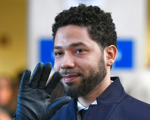 (AP Photo/Paul Beaty, File). FILE - In this March 26, 2019, file photo, actor Jussie Smollett smiles and waves to supporters before leaving Cook County Court after his charges were dropped in Chicago. An Illinois judge seems close to appointing a speci...