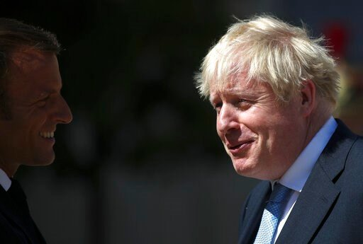 (AP Photo/Daniel Cole). French President Emmanuel Macron welcomes Britain's Prime Minister Boris Johnson at the Elysee Palace, Thursday, Aug. 22, 2019 in Paris. Welcoming British Prime Minister Boris Johnson to the courtyard of his Elysee Palace Thursd...