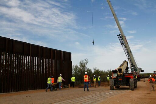 (AP Photo/Cedar Attanasio). Workers break ground on new border wall construction about 20 miles west of Santa Teresa, New Mexico, Aug. 23, 2019. The wall visible on the left was built in 2018 with money allocated by Congress, while the new construction...