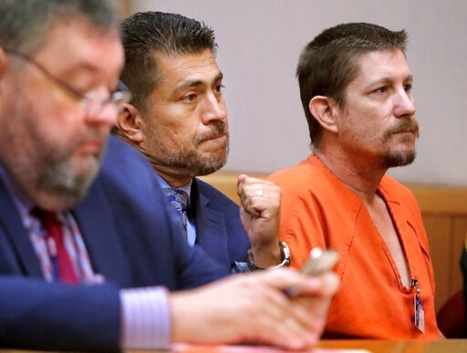 (Jim Damaske/Tampa Bay Times via AP, File). FILE - In a  Aug. 23, 2018 file photo, Michael Drejka sits in court during a bond hearing at the Pinellas County Justice Center in Clearwater, Fla.  Drejka, who fatally shot an unarmed black man during a disp...