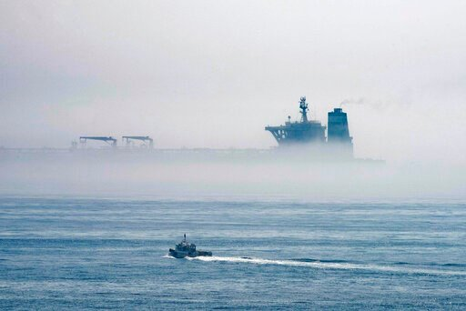 (AP Photo/Marcos Moreno). A view of the Grace 1 supertanker is seen through the sea fog, in the British territory of Gibraltar, Thursday, Aug. 15, 2019, seized last month in a British Royal Navy operation off Gibraltar.  The United States moved on Thur...