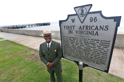 (AP Photo/Steve Helber). Terry E. Brown, Superintendent of the Fort Monroe National Monument poses next to a historical marker that signifies the spot of the first landing of Africans in America 400 years ago at Fort Monroe in Hampton, Va., Thursday, A...