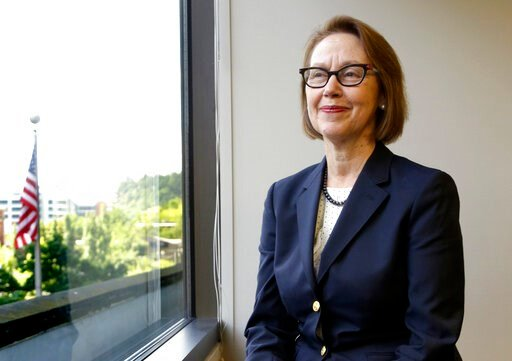 (AP Photo/Don Ryan, File). FILE - In this July 13, 2016 file photo, Oregon Attorney General Ellen Rosenblum poses for a photo at her office in Portland, Ore. Oregon's attorney general is telling the U.S. Supreme Court that Oregon's criminal justice sys...