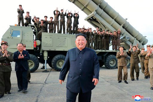 (Korean Central News Agency/Korea News Service via AP). This Saturday, Aug. 24, 2019, photo provided Sunday, Aug. 25, by the North Korean government, shows North Korean leader Kim Jong Un, center, smiles after the test firing of an unspecified missile ...
